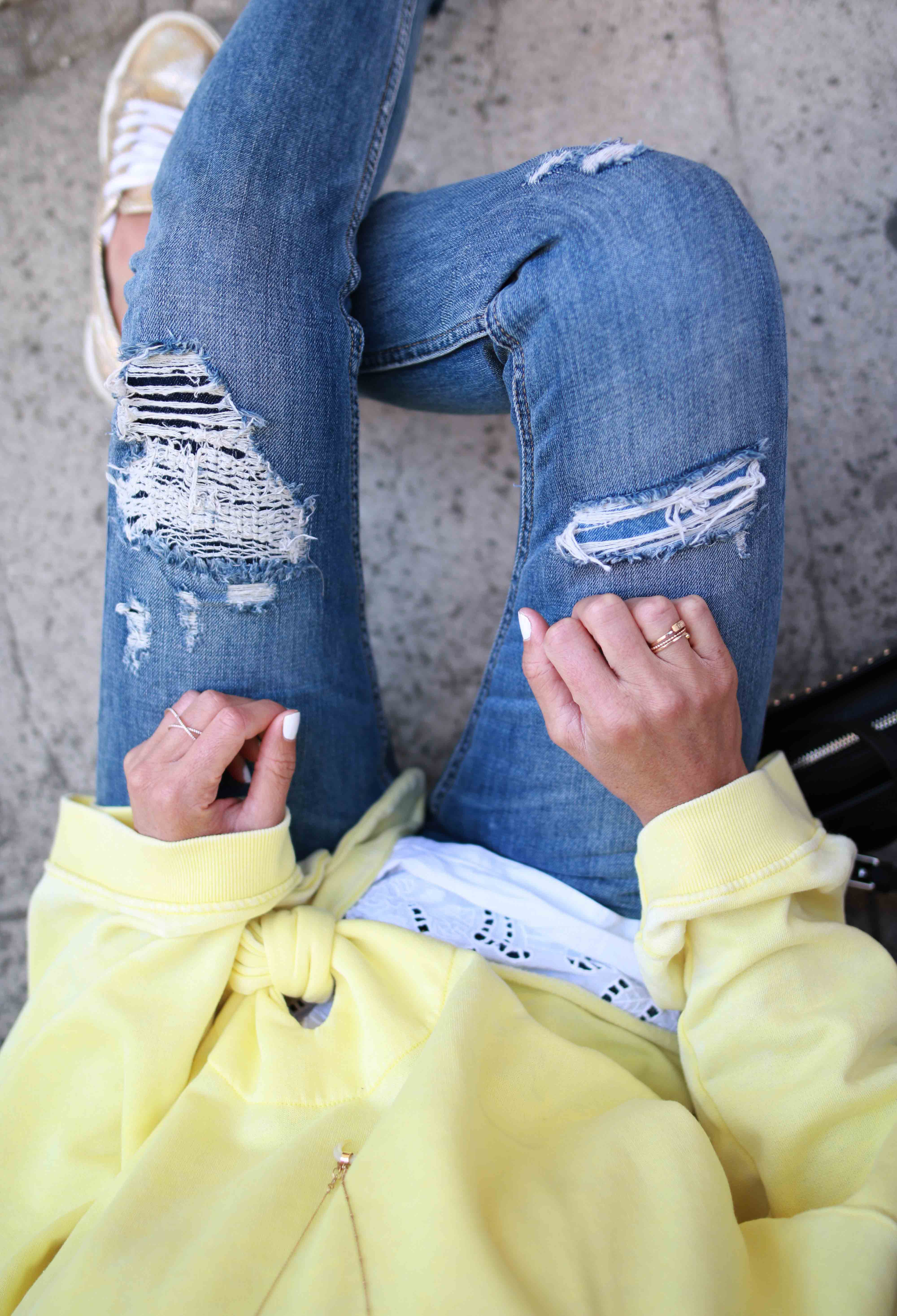 RIPPED DENIM AND YELLOW SWEATSHIRT