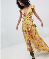 ASOS DESIGN - Robe longue à volants avec découpes au dos et imprimé floral - Jaune