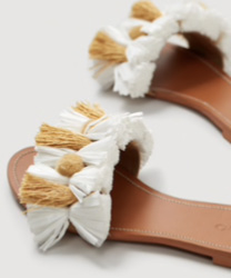 Sandales plates pompons