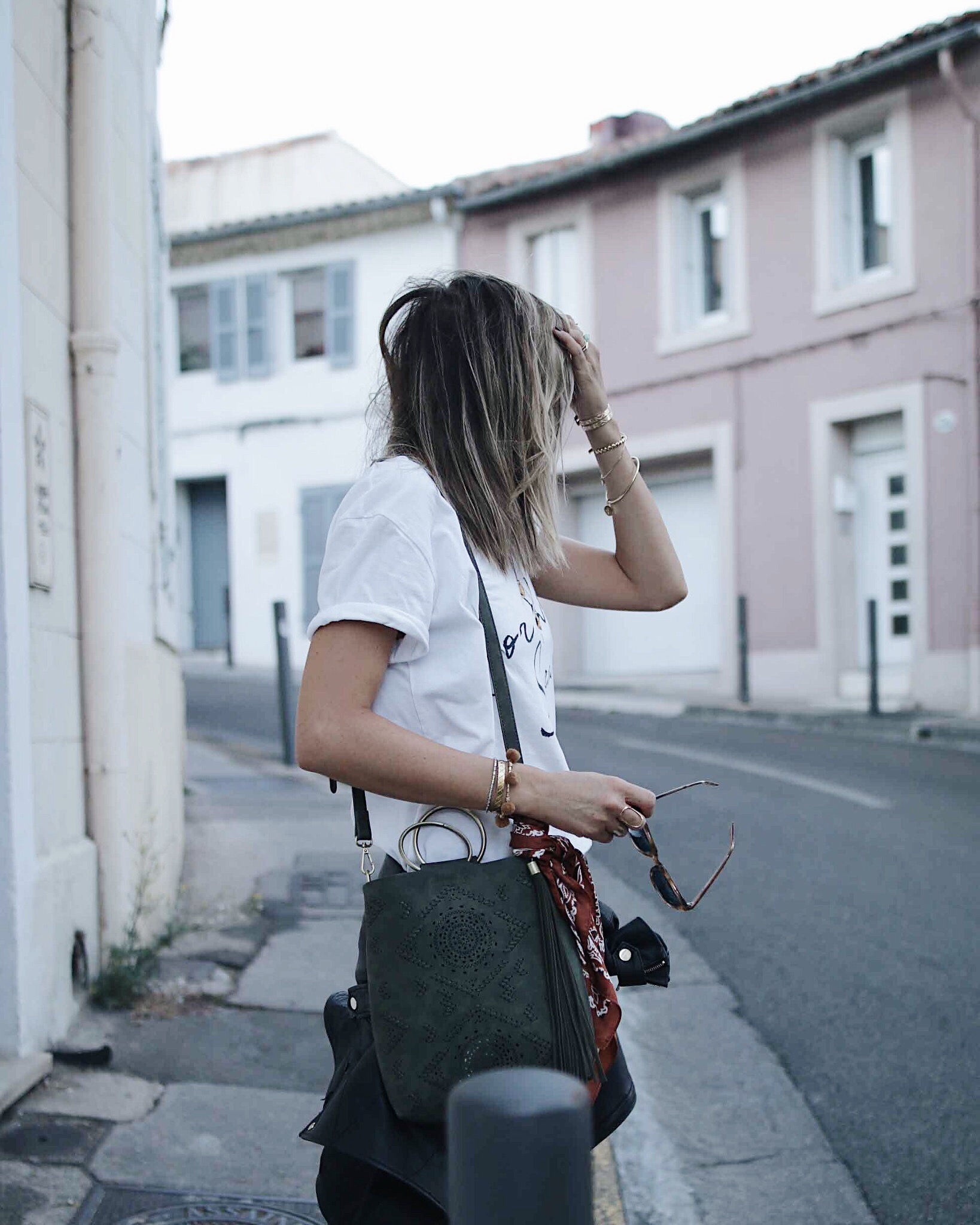 casual look with white tee-shier and denim shorts; fur converse and anthropologie bag